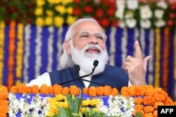 Prime Minister Narendra Modi speaks during a ceremony in Kutch district in western India, Dec. 15, 2020, in this handout photograph released by the Indian Press Information Bureau.
