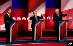 From left, Democratic presidential candidates former Maryland Gov. Martin O'Malley, former Secretary of State Hillary Clinton and Senator Bernie Sanders participate in the NBC, YouTube debate at the Gaillard Center, in Charleston, S.C., Jan. 17, 2016.