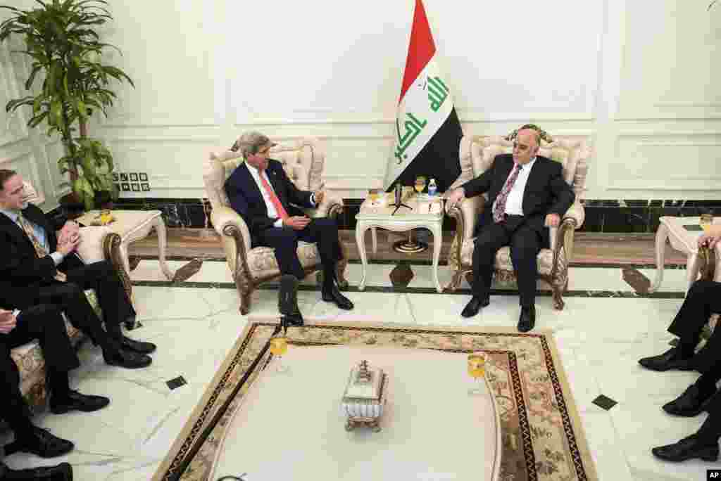 U.S. Secretary of State John Kerry, center left, speaks to new Iraqi Prime Minister Haider al-Abadi, center right, during a meeting in Baghdad, Iraq, Sept. 10, 2014.