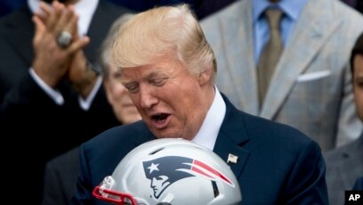 11de4425d4a President Donald Trump is presented with a New England Patriots football  helmet and jersey by Patriots
