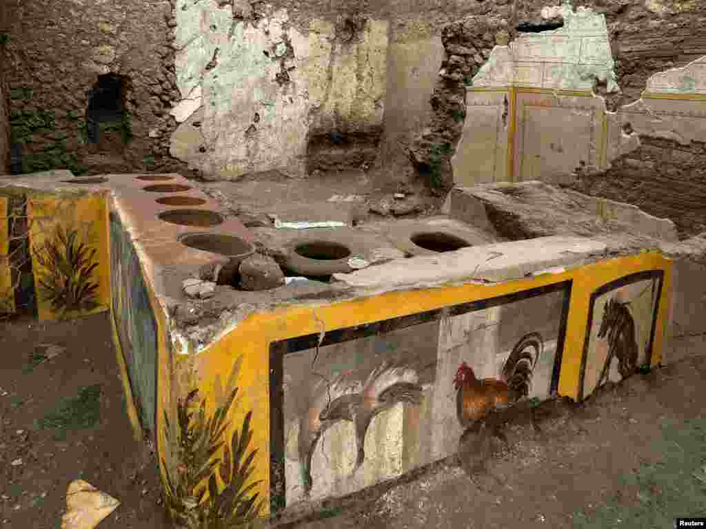 Frescoes on an ancient counter discovered during excavations in Pompeii, Italy, are seen in this handout picture released Dec. 26, 2020. (Pompeii Archaeological Park/Ministry of Cultural Heritage and Activities and Tourism/Luigi Spina)