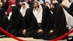 FILE - Iraqi Shiite women take part in the Eid al-Fitr prayer in Baghdad, Iraq, July 29, 2014. Islamic State is imposing a strict dress code on women in Iraq and Syria during Ramadan.