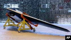 """This photo released by the Iranian Revolutionary Guard shows a new attack drone called a """"Saeqeh"""" in an undisclosed location in Iran, Oct. 1, 2016."""