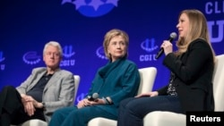 FILE - The Clintons – Bill, Hillary and daughter Chelsea – speak at a 2014 Clinton Global Initiative University at Arizona State University in Tempe. Some critics say the Clinton Foundation represents a conflict of interest for the Democratic presidential candidate.