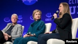 FILE - The Clintons — Bill, Hillary and daughter Chelsea — speak at a 2014 Clinton Global Initiative event at Arizona State University in Tempe.