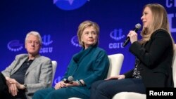 FILE - The Clintons – Bill, Hillary and daughter Chelsea – speak at a 2014 Clinton Global Initiative University at Arizona State University in Tempe. Some say the Clinton Foundation poses a conflict of interest for the Democratic presidential candidate.