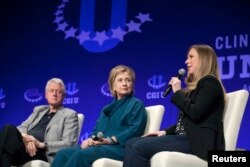 FILE - The Clintons – Bill, Hillary and daughter Chelsea – speak at a 2014 Clinton Global Initiative University event at Arizona State University in Tempe.