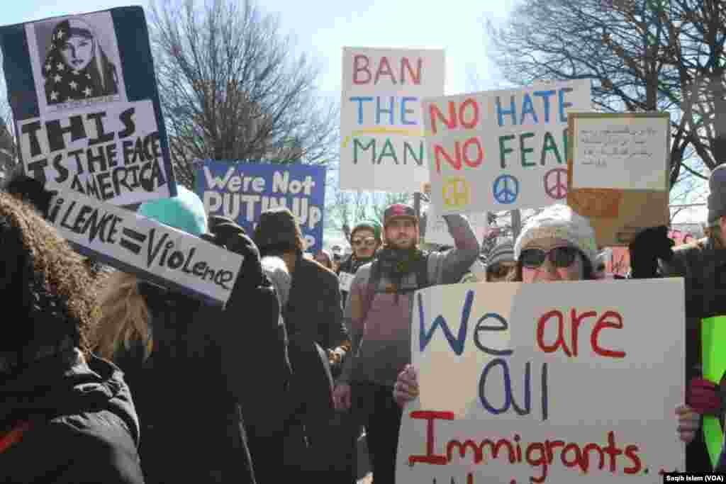 Protesters rallied and marched in Washington, D.C., Feb. 4, 2017, in support of immigrants and refugees outside the White House, along Pennsylvania Avenue and at the Capitol and Supreme Court building. (S. Islam/VOA)