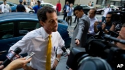 Former congressman Anthony Weiner, at the time a New York City mayoral candidate, is seen speaking to members of the media in New York, July 24, 2013. In an odd twist, the contents of his computer might now well determine who will next occupy the White House.
