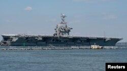 El portaaviones estadounidense Harry S. Truman parte con su grupo de batalla hacia el Medio Oriente, desde la estación naval de Norfolk, en Virginia. Abril 11 de 2018.
