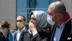 Hatice Cengiz, the fiancee of slain Saudi journalist Jamal Kashoggi, leaves a court in Istanbul, Friday, July 3, 2020, where the trial in absentia of two former aides of Saudi Crown Prince Mohammed bin Salman and 18 other Saudi nationals over the…