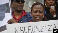 FILE - Protesters demonstrate outside U.N. headquarters in New York, calling for an end to political atrocities and human rights violations unfolding in Burundi under the government of President Pierre Nkurunziza, April 26, 2016.