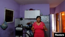 Catalina Benitez speaks during an interview with Reuters in her home in La Matanza, in the greater Buenos Aires area, July 29, 2015.