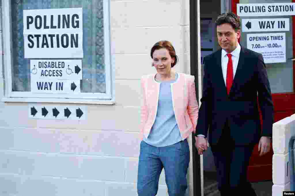 Britain's opposition Labor Party leader Ed Miliband leaves after voting with his wife Justine in Doncaster, May 7, 2015.