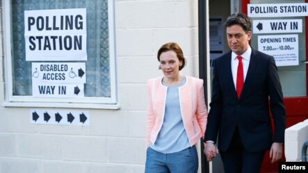 Britain's opposition Labour Party leader Ed Miliband leaves after voting with his wife Justine in Doncaster, northern England, Britain, May 7, 2015.