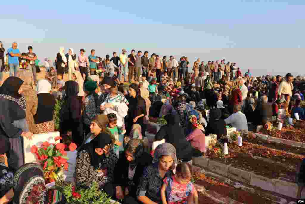 Displaced Afrin people visit the graves of their beloved ones in the eid