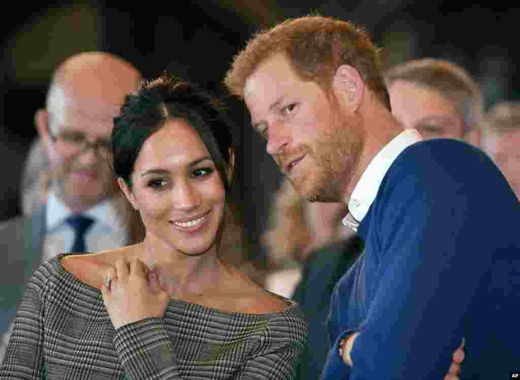 Britain's Prince Harry and Meghan Markle watch a dance performance by Jukebox Collective Cardiff Castle in Cardiff, Wales.