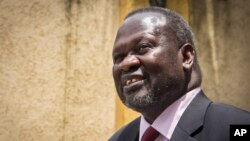 "FILE - Sudan says South Sudanese opposition leader Riek Machar is in Khartoum, where he is being treated for a leg injury and is currently in ""stable"" condition."