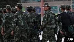Hình tư liệu - Cảnh sát vũ trang tuần tra khu vực người sắc tộc Uighur ở Kashgar, tỉnh Tân Cương, ngày 4 tháng 8 năm 2011.
