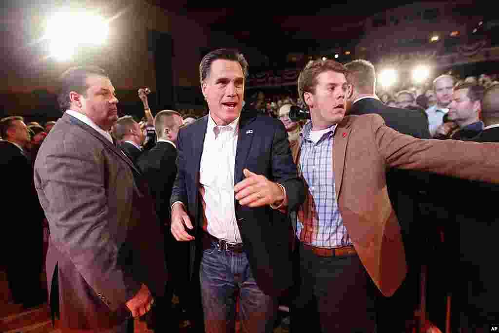 Republican presidential candidate Mitt Romney leaves the stage to greet supporters at a campaign rally at the Royal Oak Theater in Royal Oak, Michigan on February 27, 2012. (AP)