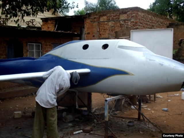 Chris Nsamba and his team work on their projects in his mother's backyard. (Photo: African Space Research Program)
