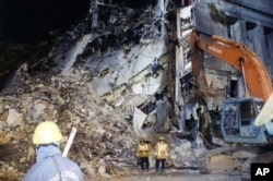 This undated photo provided by the FBI shows damage to the Pentagon caused during the 9/11 attacks. This photo and others disappeared from the FBI website for a time because of a technical glitch. A bureau spokeswoman said she didn't know how long the photos weren't visible.