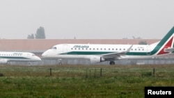 Alitalia planes ready to take off at Linate airport in Milan, Italy, Oct. 10 ,2013.