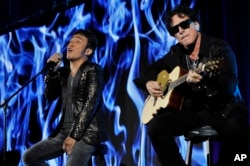 FILE - Arnel Pineda, left, and Neal Schon of the rock band Journey perform at the PBS Summer 2013 TCA press tour at the Beverly Hilton Hotel in Beverly Hills, Calif., Aug. 6, 2013.
