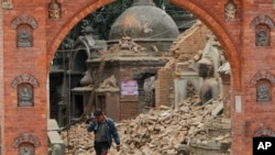 A Nepalese man cries as he walks through the earthquake debris in Bhaktapur, near Kathmandu, Nepal, April 26, 2015.