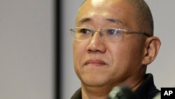 FILE - Kenneth Bae, who had been held in North Korea since 2012, waits to talk to reporters at Joint Base Lewis-McChord, Washington, Nov. 8, 2014.
