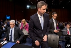 From left, Facebook general counsel Colin Stretch, Twitter acting general counsel Sean Edgett and Google information security director Richard Salgado arrive for a Senate panel's hearing on Capitol Hill in Washington, Oct. 31, 2017.