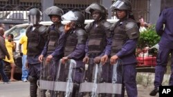 FILE - Liberia security forces in riot gear in the city of Monrovia, Liberia, Aug. 20, 2014.