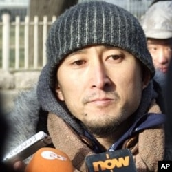 """Yang Licai , 38,was one of thousands of Chinese citizens who signed """"Charter '08."""" Yang came to the courthouse on Friday, the day of Liu Xiaobo's sentencing, to turn himself in to authorities in solidarity with the convicted dissident."""