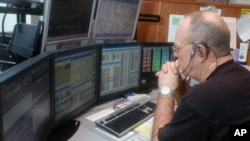 In this 2007 file photo, emergency dispatcher Larry Holmes responded to a call in Versailles, Missouri.