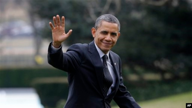 President Barack Obama waves following his arrival on Marine One helicopter from the House Democratic Issues Conference in Lansdowne, Virginia, as he walks across the South Lawn of the White House in Washington, February 7, 2013.