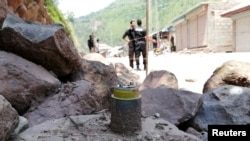 A cluster bomb shell is seen along a roadside in Noseri, near the line of control (LOC), in Neelum Valley in Kashmir August 4, 2019.