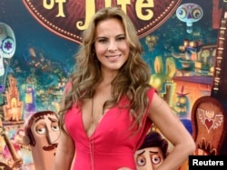 """FILE - Cast member Kate del Castillo poses during the premiere of the film """"Book of Life"""" in Los Angeles, California, Oct. 12, 2014."""