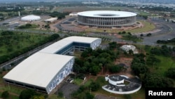An aerial view of the Mane Garrincha National Stadium (R) and the Convention Center Ulysses Guimaraes in Brasilia, Brazil, Jan. 20, 2014.