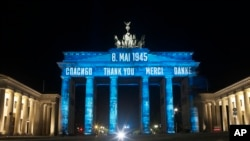 Germany's landmark the Brandenburg Gate is illuminated to mark the 75th anniversary of Victory Day and the end of World War II in Europe, in Berlin, Germany, May 8, 2020.