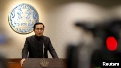 Thai Prime Minister Prayuth Chan-ocha attends a news conference as the junta marked the third anniversary of a military coup in Bangkok, Thailand, May 23, 2017.