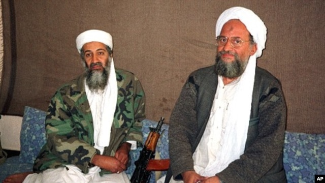 Osama bin Laden (L) sits with al-Qaida's top strategist and second-in-command Ayman al-Zawahri in this 2001 file photo.