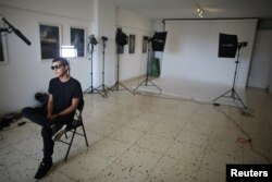 Robin Pedraja, 29, editor of the digital magazine Vistar, speaks during an interview at its studio in Havana, Cuba, Aug. 11, 2016.
