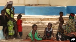 Children suffering from lead poisoning wait to see medical workers, in Gusau, Nigeria, June 9, 2010.
