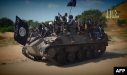 FILE - Screengrab from a Boko Haram video shows Boko Haram fighters parading on a tank in an unidentified town.