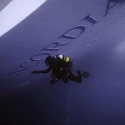 A diver inspects the Costa Concordia on Thursday