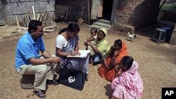 Census officials collect details from village women during first phase of the census at Hatkhuwapara Village, near the northeastern Indian city of Guwahati, India (File)