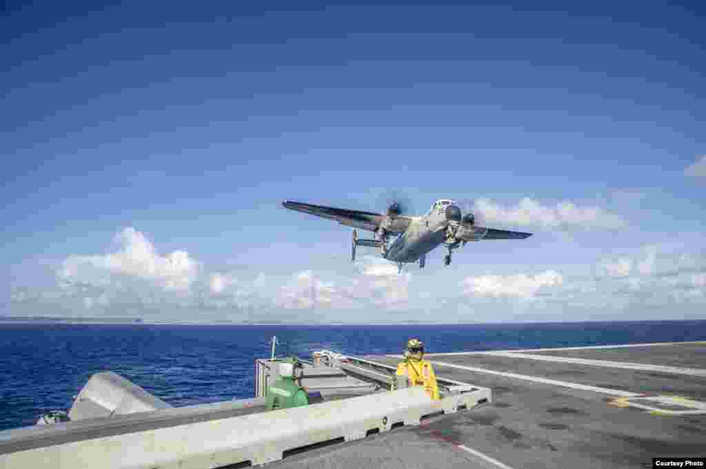 A C-2A Greyhound carrying relief supplies for Operation Damayan prepares to land on the flight deck of the U.S. Navy's forward-deployed aircraft carrier USS George Washington, Nov. 15, 2013. (U.S. Navy)