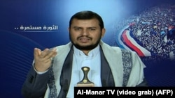 Yemeni Shi'ite Houthi movement leader Abdel-Malek al-Houthi, whose fighters seized the presidential palace, delivers a televised statement from an undisclosed location in the Saada governorate, northwest Yemen, Jan. 20, 2015.