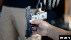 FILE - A gun is surrendered during a buyback event at Los Angeles Sports Arena in Los Angeles, California. May 31, 2014. A federal appeals court ruled Thursday that U.S. citizens do not have a constitutional right to carry concealed weapons in public.