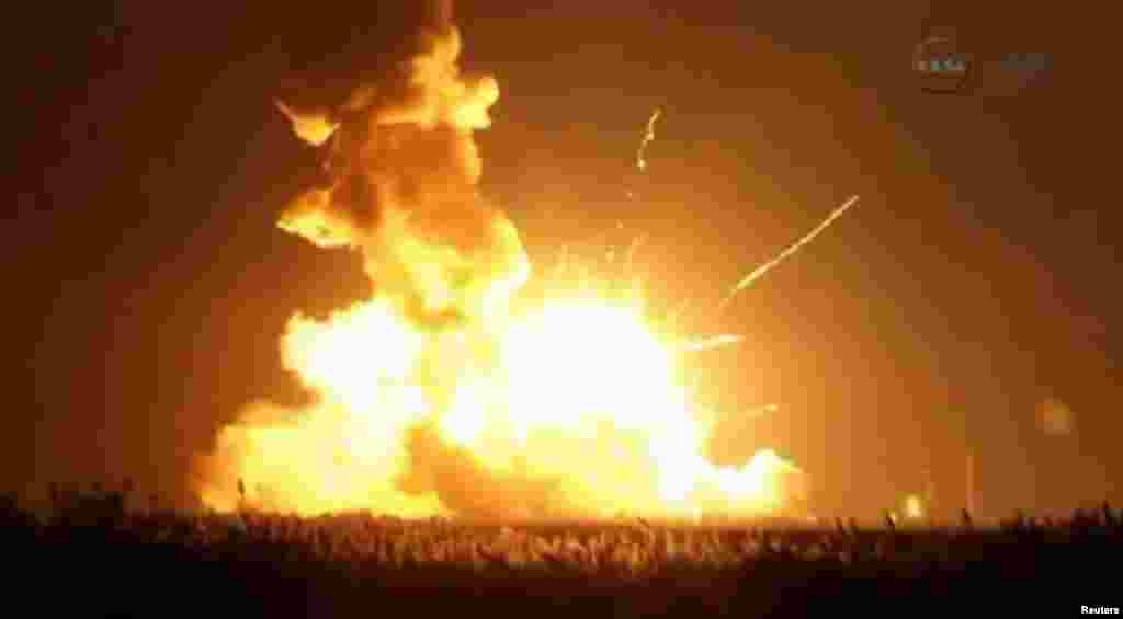 An unmanned Antares rocket is seen exploding seconds after lift off from a commercial launch pad in this still image from NASA video at Wallops Island, Virginia, Oct. 28, 2014.